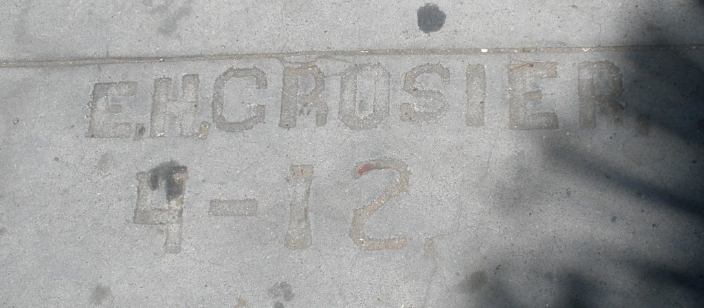 Edward Crosier carved this inscription into the sidewalk in front of his home at 852 Reed, next to the Doyle house, built in 1912.